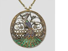 An emerald, diamond, cultured pearl, ruby and sapphire peacock motif necklace, French, circa 1910 \ JV