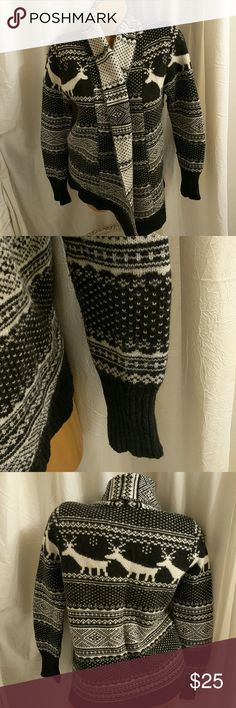 Beautiful lamb's-wool cardigan Very beautiful lamb's-wool black and winter white cardigan. Has adorable deer print. EUC. I absolutely love this sweater, but unfortunately I have an allergy to wool. ☹️ Sweaters Cardigans