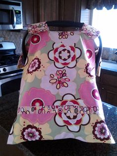 Car seat Canopy Cover from Peek-a-Boo Covers. $29.00 Includes Velcro Handles and Double perimeter Border to make your cover stand out from the rest. Visit our page to order you custom canopy cover.