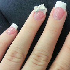 french manicure with glittery pink and a bow