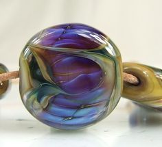 Blue, purple, golden taupe lampwork bead by skyvalleybeads