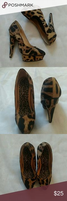 Cheetah print platform high heels Shoes are in great condition. Only worn once. Bottom of one has some residue on it with some dirt, but otherwise they are great. Colin Stuart Shoes Platforms