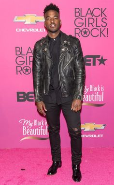 Singer Luke James rocks an all black outfit and looks mighty handsome doing it.