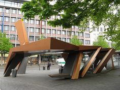 this bus stop is located in Germany and was designed by the architect Peter Eisenman. It was built in Urban Furniture, Street Furniture, Bus Stop Design, Plaza Design, Bus Shelters, Deconstructivism, Shelter Design, Travel Around The World, Around The Worlds