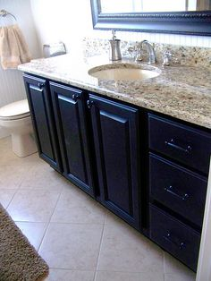 LOVE the black cabinets.