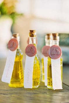 The couple tied the knot at Cordiano Winery in Escondido, California, and celebrated with a Tuscan + Italy-inspired microwedding complete with pizza, Champagne and olive oil favors for guests. Notably, wax seals with cat motifs accented the olive oil wedding favor bottles and a nod to their feline pets. Cat wedding inspo; pet wedding inspiration