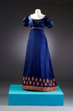 Long dark blue dress with patterned hem line (Regency/Jane Austen Fashion) Number: BATMC Material(s): silk Technique(s): woven (satin) and embroidery (chain s. 1800s Fashion, 19th Century Fashion, Fashion Mode, Vintage Fashion, Vintage Outfits, Vintage Gowns, Vintage Mode, Regency Dress, Regency Era