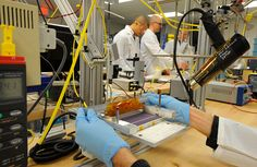 Almost finished: A 1366 Technologies engineer completes construction of a solar cell for testing. Sustainable Engineering, Solar Companies, Energy Technology, Alternative Energy, Dog Days, Climate Change, Discovery, Construction, Science