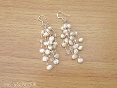 White freshwater pearl earrings with crystal on by CuteActually