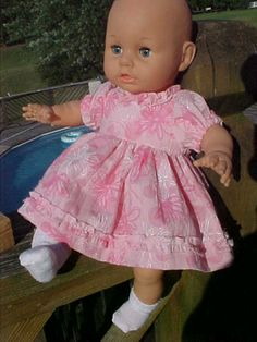 remade from baby dress--used trim from bodice around the neck of dolls bodice.  Used existing skirt of baby dress for the skirt of doll dress.