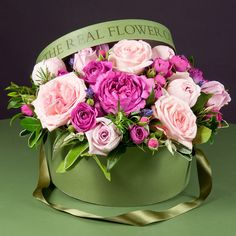 This highly scented mixed pink hatbox arrangement showcases the best of our exquisite pink and fabulously scented garden roses. Arranged with our garden herbs and foliage in oasis in a stylish hatbox, the flowers needs no further arranging on delivery.