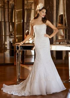 Fit and flare- Fitted sheath dress that gradually flares out in a trumpet shape. It resembles acombination of a dropped waist A-line and a modified mermaid. Love this Galina Signature dress from David's Bridal. Looks way better on!