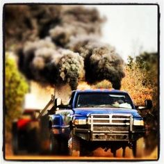 www.DieselTruckGallery.com Dodge Ram Cummins Truck Pull Rollin Coal Like a Freight train