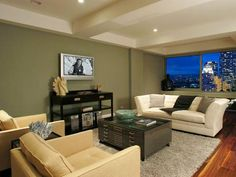 Designer's Notes  The dramatic city skyline provides a colorful view from this warm and contemporary living room.