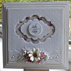 Another card for you today, Spellbinders dies used are ,grand squares , labels twenty, bracket borders one, classic circle, sentiment is from justrite stamps, dainty dot embossing folders , flowers from wild orchid crafts, foliage is a martha stewart branch punch, the paper is download from here