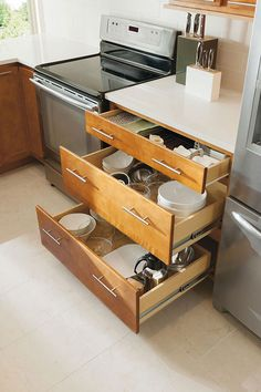 Our Three Drawer Base Cabinet easily fits your pots, pans and other large items.