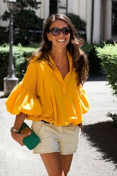 Yellow/Orange top with puff sleeves  and beige shorts