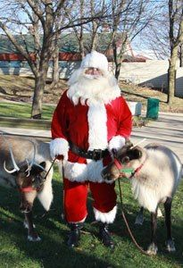 Santa and his reindeer come to the Zoo every December!