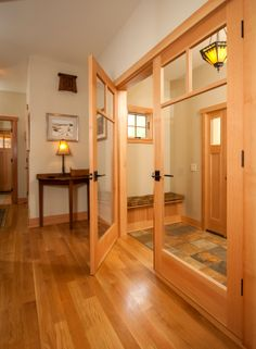 Completed custom home interior, entrance with tile flooring and glass doors to mudroom. Louden Ridge, Saratoga Springs, NY