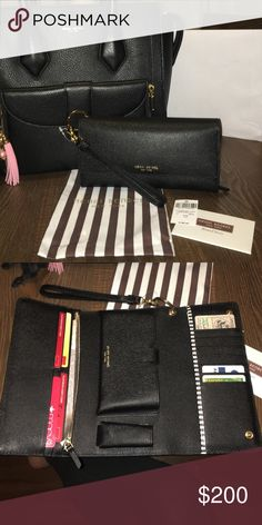 Black Uptown daily Organizer wrist wallet Finally came in after weeks of being on back order! Holds an iPhone 6s. Yayy  I'll part with it for the right price. henri bendel Bags Wallets