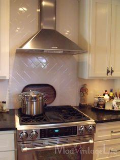 Kitchen Backsplash Behind Stove recessed backsplash behind stove being used as counterspace; white