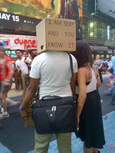 He's sexy and he knows it. Only in Times Square, NYC, would people pay to have their pic taken with a guy with a box on his head!
