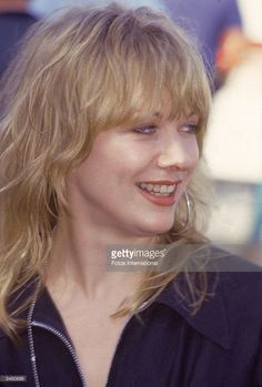 Portrait of musician Nancy Wilson of the rock group Heart looking aside and smiling, circa 1994.