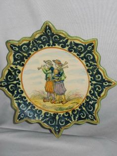 """QUIMPER FRENCH FAIENCE POTTERY PLATE. UNUSUAL SHAPED PLATE WITH POINTED EDGE DESIGN. SIGNED ON BACK """"H.R. QUIMPER."""" SMALL CHIP ON BACK OF ONE POINT. 9"""" X 9"""". 2 LBS. VGC."""