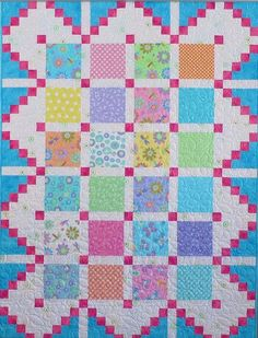"This quilt is super easy and fast to make. Great for beginner on up! It would make a wonderful scrap quilt. You can also personalize the quilt by using novelty fabrics in the 6"" center blocks. The bor"
