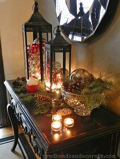 Christmas decor, love the filled lanterns