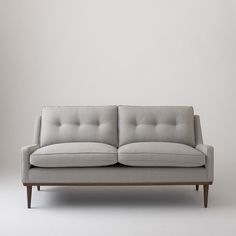Typified by a thoroughly modern but understated elegance, the Jack Loveseat has a presence that transcends its low-profile stature. Every detail -- from the splayed hardwood legs and low-slung arms to the subtly tufted cushions -- is an ode to mid-century design. With a solid wood frame and plush cushioning, this loveseat is an effortless and comfortable addition to any interior.