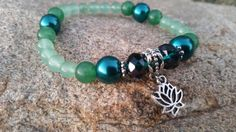 Check out this item in my Etsy shop https://www.etsy.com/listing/247073484/sale-beaded-zen-bracelet-lotus-flower