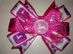 Pink John Deere inspired hair bow with alligator clip on Etsy, $6.50