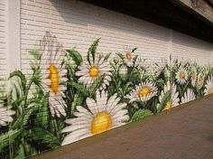 sunflowers painted on a brick wall