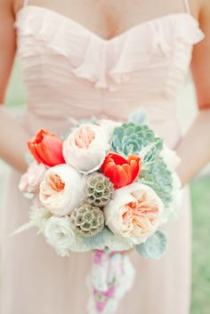 Peach coral orange wedding bouquet baby's Breath, hydrangea, garden roses, tulips, scabiosa pods, spray roses, astilbe, dusty miller, silver brunia