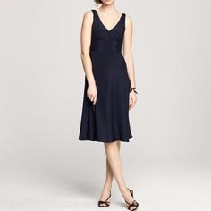 """HPNew J.Crew dress This is an absolutely beautiful silk dress from J.Crew. I am so disappointed to part with this dress, but I hate to see it hanging in my closet. The color is navy blue and the size is 10. The style number is 62983 and the name is """"Sophia dress in silk tricotine"""" if you would like to search online for more photos. J. Crew Dresses"""