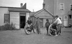 Group of Gleichen boys playing in rubber tires, Alberta, ca. 1920.  vintage everyday: Children Playing – Vintage Photos of Children's Fun That Could Have Lost Today