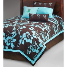 Get your passport ready because your personal island getaway is well within reach with the Kathy Ireland Home by Hallmart Collectibles Island Escape Comforter Set. This fun ensemble emits a cool surfer vibe and features a lively teal floral print atop a chic chocolate brown background making it the perfect scheme for a girl or boy's room. Extra cording for maximum durability dry clean only.Comforter DimensionsTwin: 86L x 68W inchesFull: 86L x 86W