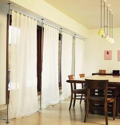 floor to ceiling curtain rods require no drilling -- perfect for apt living