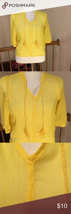 ON SALE 🎉Old Navy yellow top women's size small ON SALE🎉  Old Navy cute yellow sheer top w/ tassels women's size small  Tassels give it an adorable little touch of detail!  3/4 sleeves  Used, no stains, smoke free home  **a small area has been reinforced/sewed as shown in 3rd picture. A small snag only noticeable when looked at closely as shown in last picture**  Bundle items for discount 😊  A31 Old Navy Tops Blouses