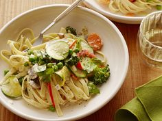 Pasta Primavera : Put the bounty of springtime produce to work in Ree's veggie-focused pasta, featuring fresh zucchini, earthy mushrooms and broccoli. For the sauce, she opts for a white wine-spiked cream sauce made especially decadent with the addition of nutty Parmesan.