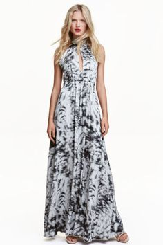 Satin maxi dress: Long halterneck dress in patterned satin in a narrow cut at the top with a cut-out section at the front, hook-and-eye fasteners and ties at the back of the neck, a concealed zip at the back, a seam at the waist and a gently flared skirt. Lined.