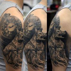 Realistic 3d Upper Arm Anubis Tattoo On Male