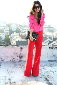Pair a hot pink dress shirt with red wide leg pants for a stylish office ensemble.  Shop this look for $69:  http://lookastic.com/women/looks/sunglasses-necklace-dress-shirt-clutch-bracelet-wide-leg-pants/7533  — Black Sunglasses  — Gold Necklace  — Hot Pink Dress Shirt  — Black Sequin Clutch  — Gold Bracelet  — Red Wide Leg Pants