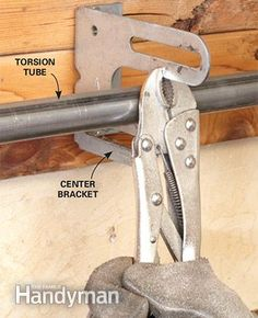 Advanced Garage Overhead Door Repairs: With the torsion tube clamped, disconnect the lift cables and move on to the next step of the overhead door repair. Read more: http://www.familyhandyman.com/doors/garage-door-repair/advanced-garage-overhead-door-repairs/view-all