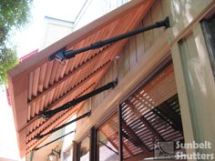 Sunbelt Shutters Bahamas serve as an awning over a patio's sliding glass doors. Install 3 stained We. Bermuda Shutters, Bahama Shutters, Cedar Shutters, Window Shutters, Window Awnings, California Shutters, Types Of Shutters, Board And Batten Shutters, Curved Pergola