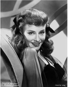Actress Paulette Goddard - love the cute double hair bows.