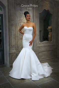 A Satin Strapless Fitted Fishtail With Contouring Seams To Frame The Natural Curves Of Body