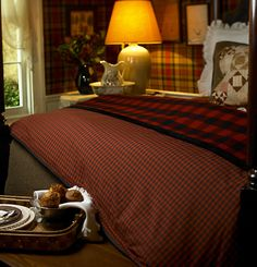 A Scotland-inspired bedroom.          good grief, I recognize that tartan wall paper, I stayed in this B&B in Edinburgh.