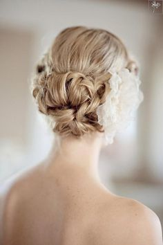 love the updo and flower, the flower would still look nice with a veil over it. (maybe not so large though)